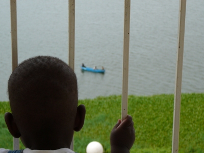 Judah Watches the Fishermen on Lake Victoria